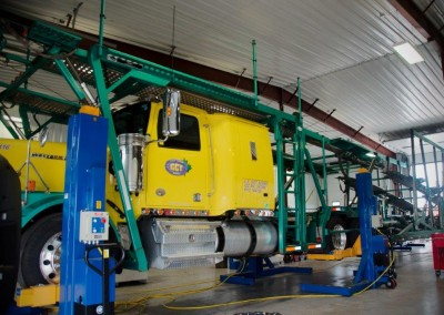 One of our trucks in our state of the art repair facility on our brand new lifts.