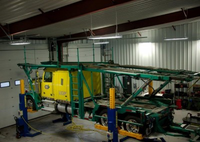 Another angle of our repair facility and our trucks on the lifts.